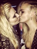 Don't look now, Rita Ora! Cara Delevingne shares sexy kiss with Sienna Miller at Met Ball