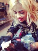 Copying Rihanna and Justin Bieber? Rita Ora turns tattoo artist