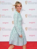 Sienna Miller still leading the fash-pack as she attends the TV Baftas with cute clutch