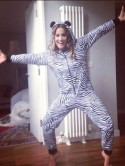 Harry Styles' ex Caroline Flack has fun in zebra onesie - shame her sexy legs are hidden