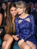 No tongues please! Taylor Swift makes 'ugh' face as Selena Gomez and Justin Bieber kiss at Billboard Music Awards